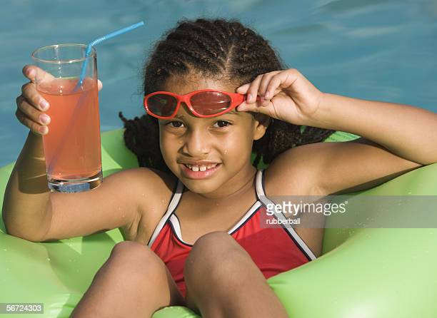 Portrait of a girl on float in a pool