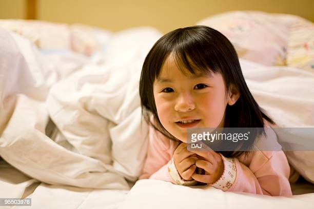 Portrait of a girl on Futon, smiling