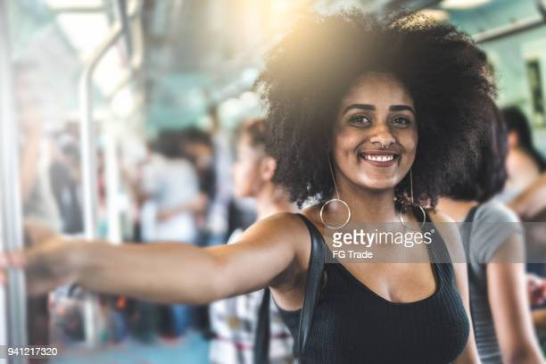 portrait of a girl on subway - crowded subway stock photos and pictures