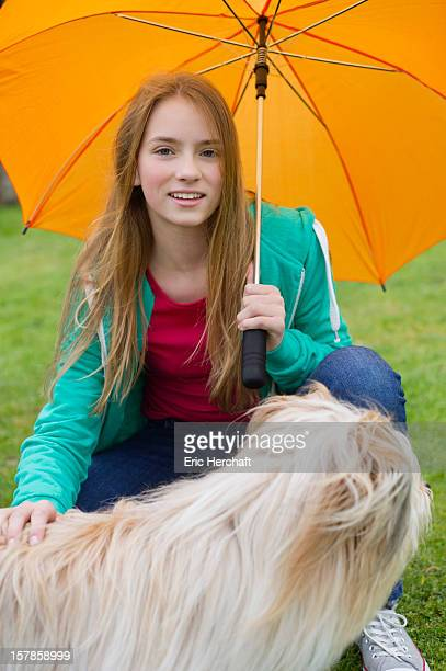 Portrait of a girl pampering her dog
