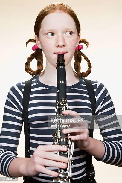 portrait of a girl playing a clarinet - clarinetto foto e immagini stock