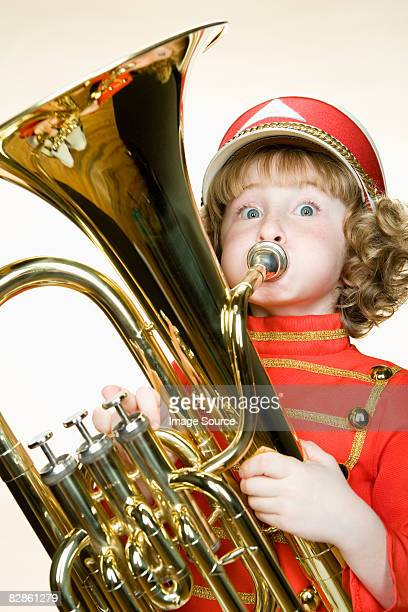Portrait of a girl playing the tuba