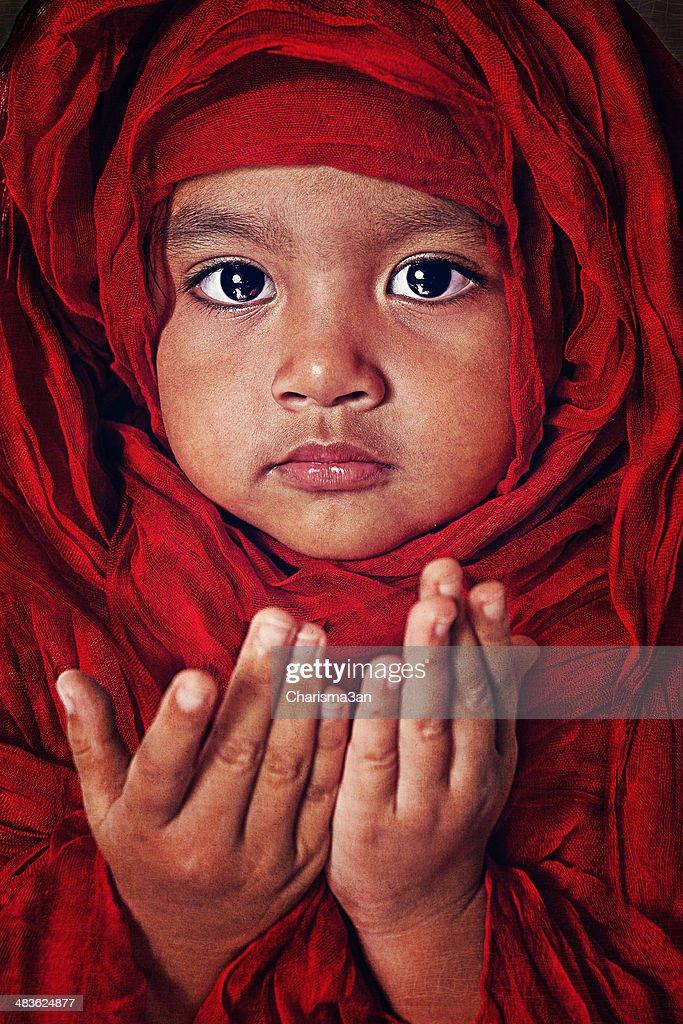 Portrait of a girl praying : Stock Photo
