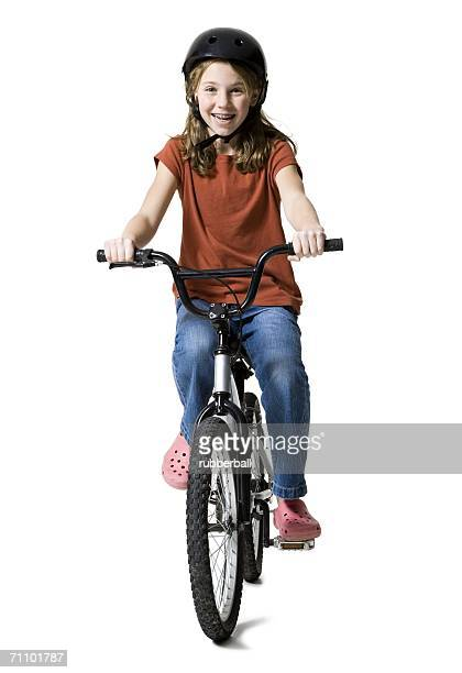Portrait of a girl riding a bicycle