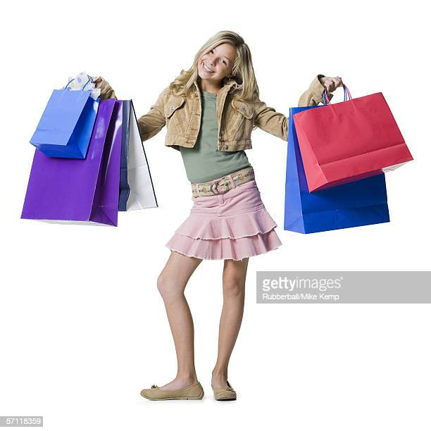 Portrait of a girl showing shopping bags and smiling