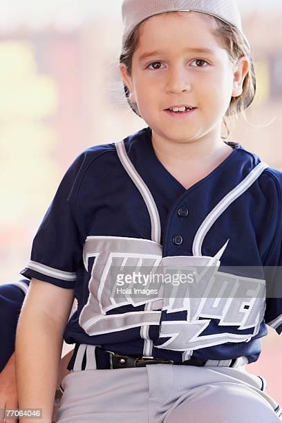 portrait of a girl sitting in a restaurant - 野球のユニフォーム ストックフォトと画像