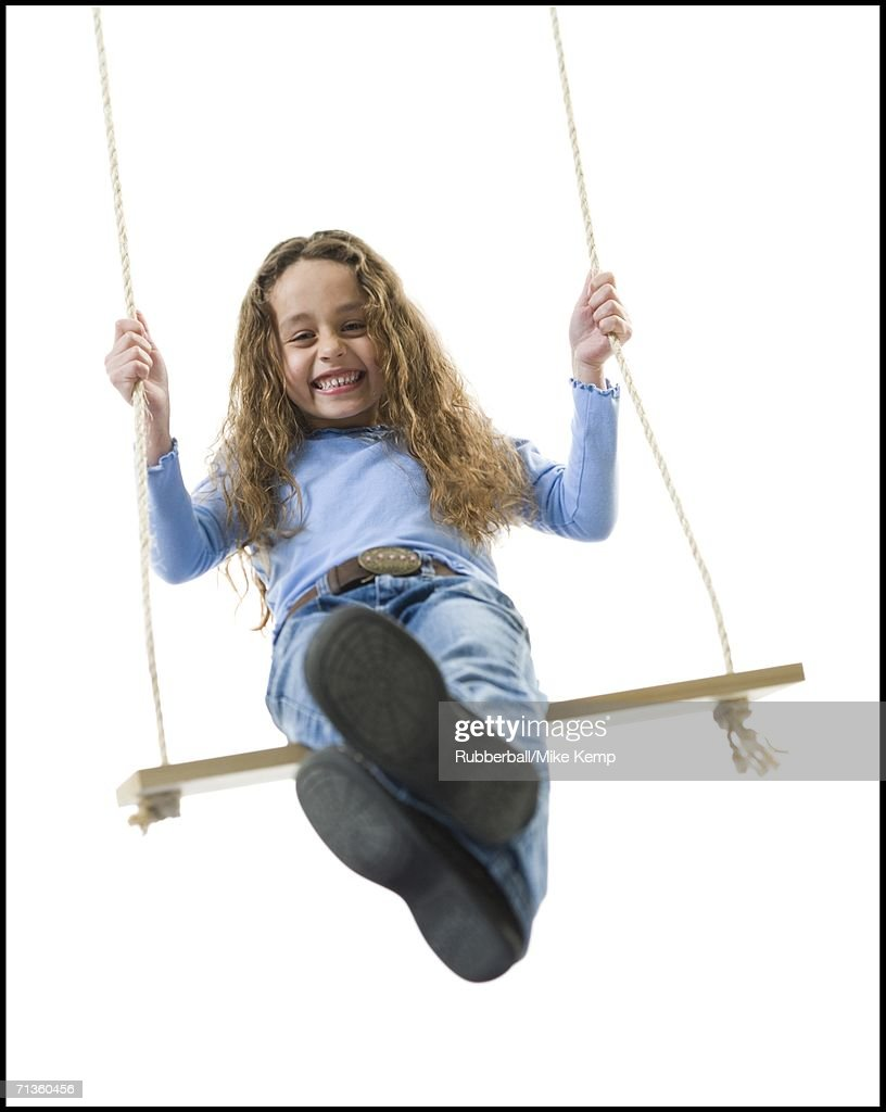 girl-sitting-on-a-swing