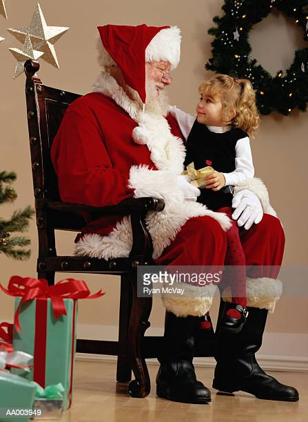 Portrait of a Girl Sitting on Santa Claus's Lap