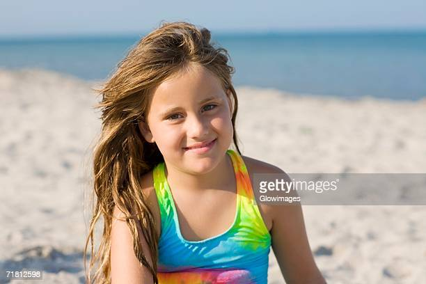 Portrait of a girl smiling on the beach