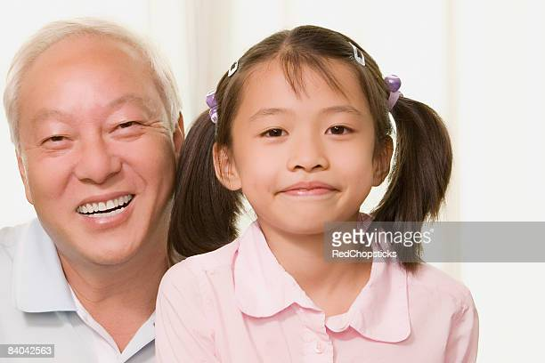 Portrait of a girl smiling with her grandfather