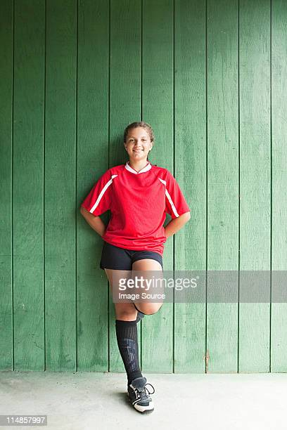 portrait of a girl soccer player - green shorts stock photos and pictures