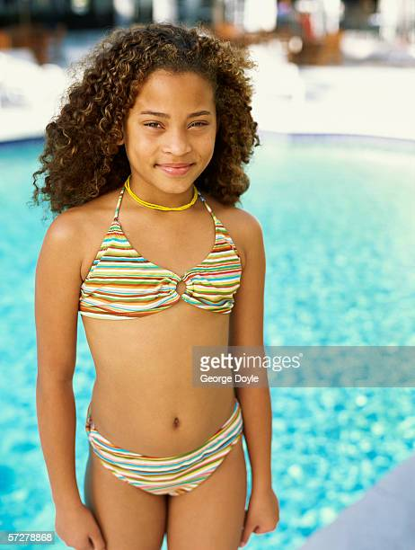 portrait of a girl standing by the poolside - one piece swimsuit stock pictures, royalty-free photos & images