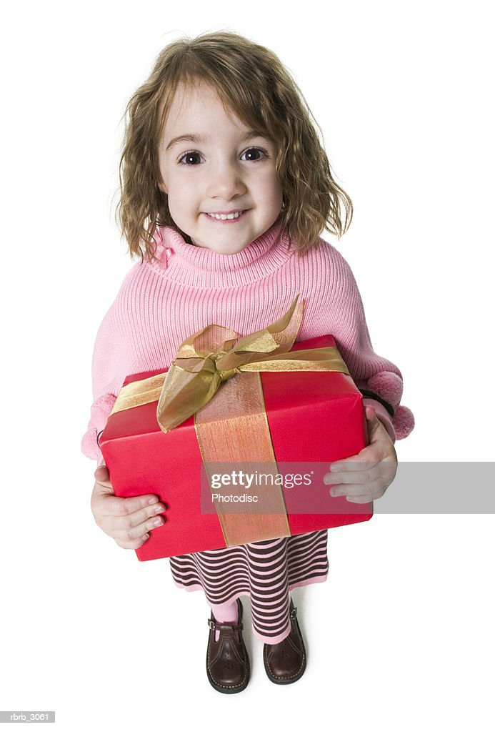 Portrait of a girl standing holding a gift : Foto de stock