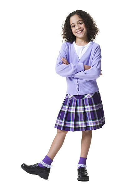portrait of a girl standing with her arms crossed - tween girls in skirts stock pictures, royalty-free photos & images