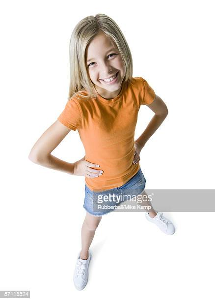 portrait of a girl standing with her hands on her hips and smiling - legs apart stock pictures, royalty-free photos & images