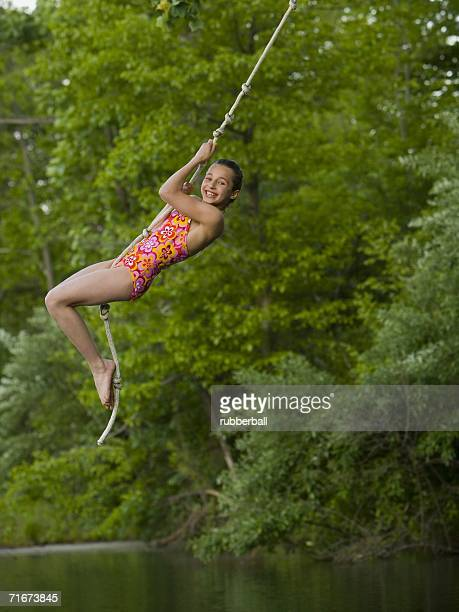 Portrait of a girl swinging on a rope