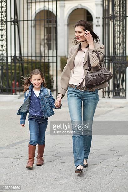 Portrait of a girl walking with her mother