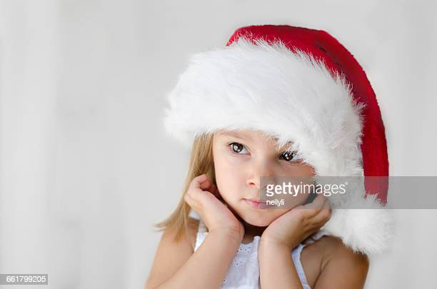 Portrait of a Girl wearing a christmas santa hat