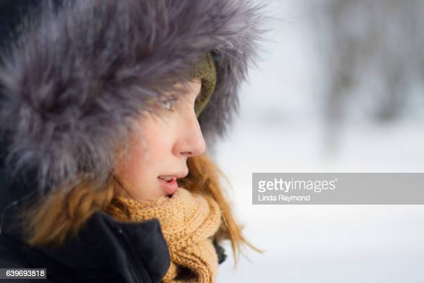 Portrait of a girl wearing a fur cap during winter