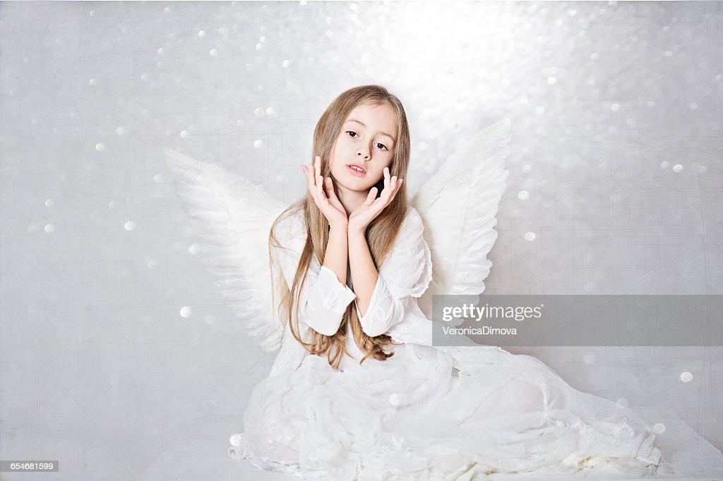 Portrait of a Girl wearing angel wings : Stock Photo