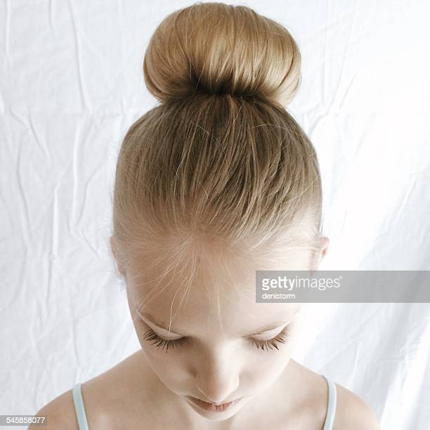 portrait of a girl with a hair bun looking down - up do stock pictures, royalty-free photos & images