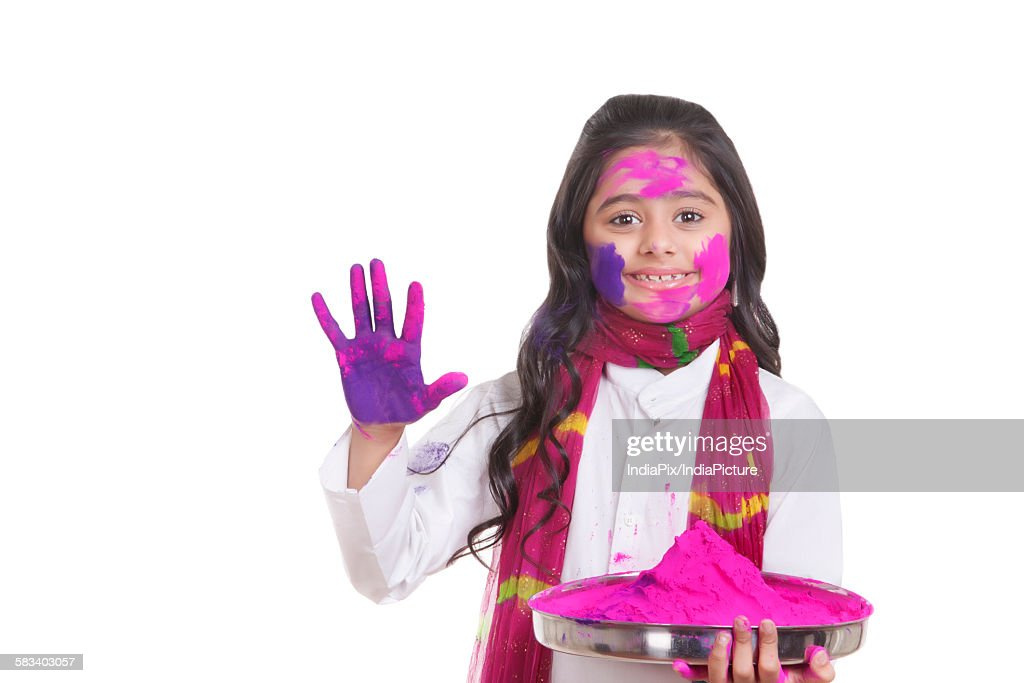 Portrait of a girl with a thali of holi colour : Stock Photo