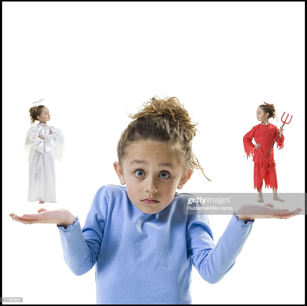 Portrait of a girl with being tempted by good and bad conscience : Stock Photo