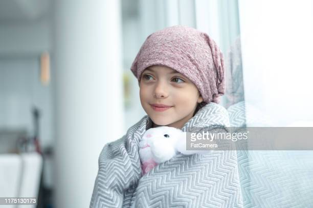 portrait of a girl with cancer holding a stuffed toy - fatcamera stock pictures, royalty-free photos & images