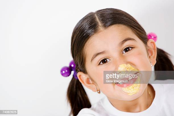 Portrait of a girl with cream on her face