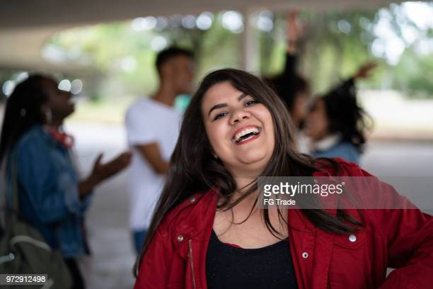 portrait of a girl with friends dancing on background - authenticity - chubby teen stock pictures, royalty-free photos & images