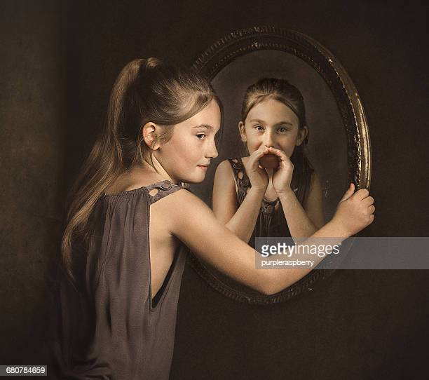 Portrait of a girl with her alter ego whispering to her in a mirror