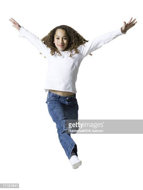 Portrait of a girl with her arms outstretched