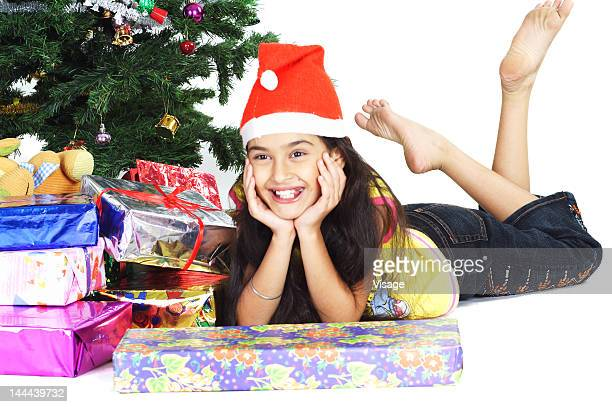 portrait of a girl with her christmas presents - barefoot feet up lying down girl stock photos and pictures