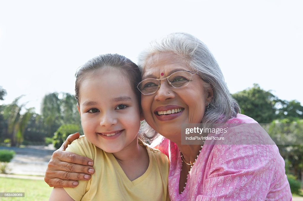 Portrait of a girl with her grandmother : Stock Photo