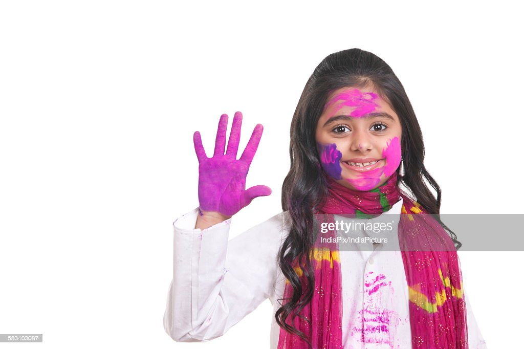 Portrait of a girl with holi colour on her hand : Stock Photo