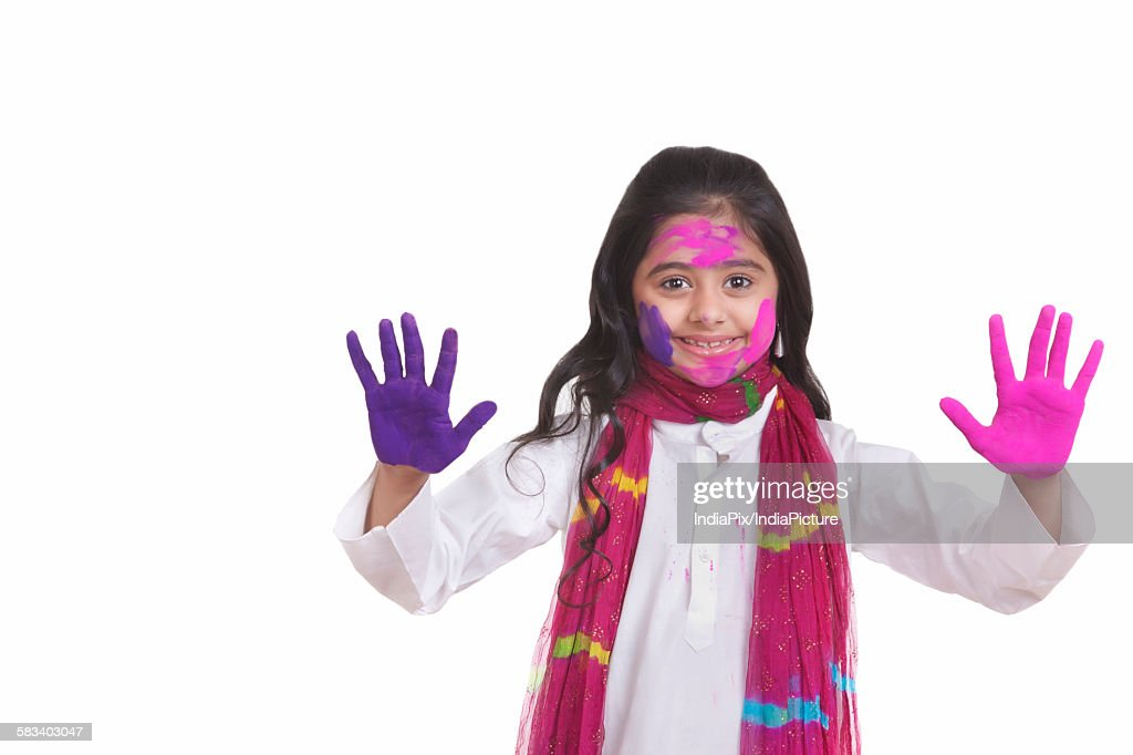 Portrait of a girl with holi colour on her hands : Stock Photo