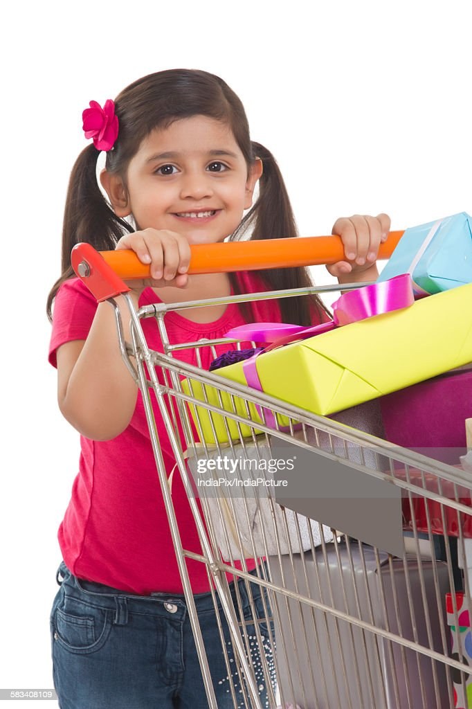 Portrait of a girl with shopping cart : Stock Photo