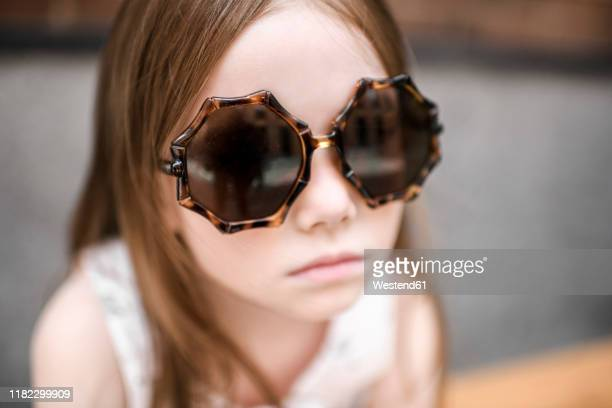 portrait of a girl with sunglasses - thick rimmed spectacles stock photos and pictures