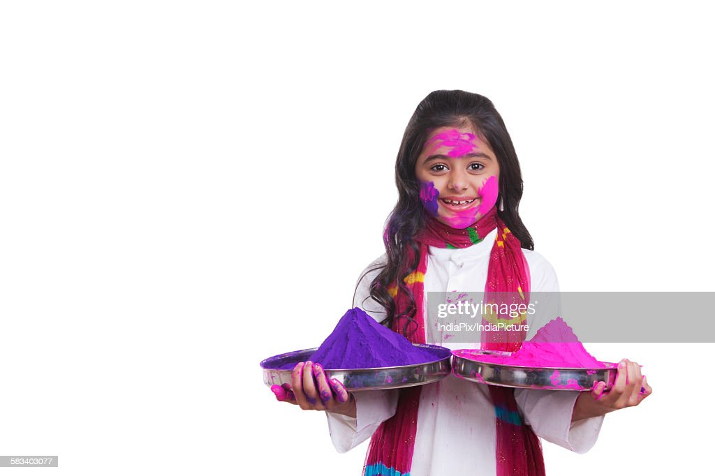 Portrait of a girl with thalis of holi colour : Stock Photo