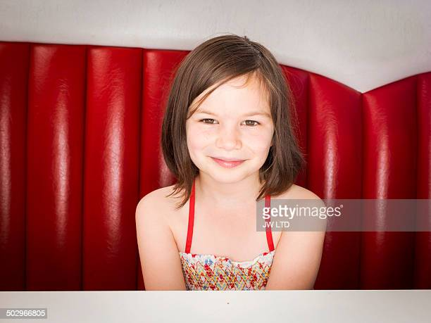 portrait of a girl (10-11) years in diner - 10 11 years stock pictures, royalty-free photos & images