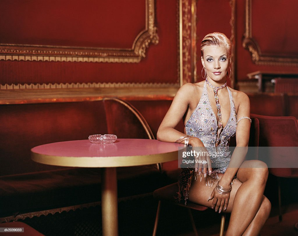Portrait of a Glamorous Ballroom Dancer Sitting at a Table in a Night Club : Stock Photo