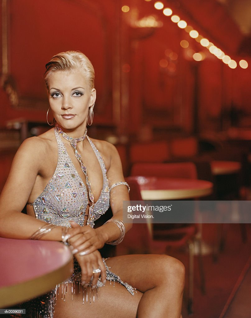 Portrait of a Glamorous Ballroom Dancer Sitting at a Table : Stock Photo