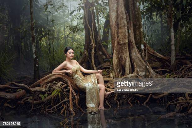 Portrait of a glamorous woman in forest, Thailand