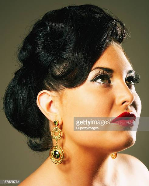 portrait of a glamorous woman looking up and away - chubby stockfoto's en -beelden