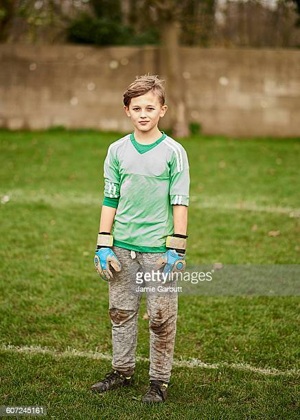 portrait of a goalkeeper with dirty knees - goalkeeper stock pictures, royalty-free photos & images