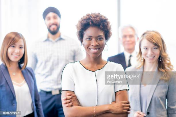portrait of a good-looking and diverse group of business people - fatcamera stock pictures, royalty-free photos & images