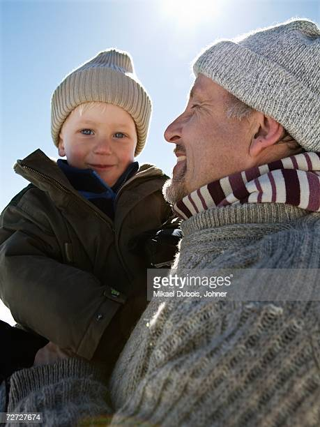 Portrait of a grandfather with his grandson.