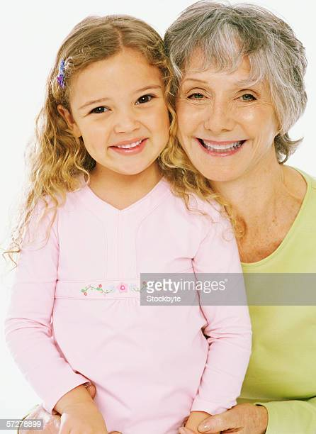 Portrait of a grandmother holding hands with her granddaughter
