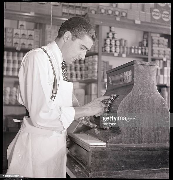 Portrait of a grocer at a cash register Photograph circa 1950's