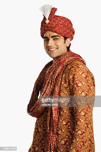 portrait of a groom in traditional wedding outfit - kurta stock pictures, royalty-free photos & images